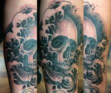 Skull and water tattoo