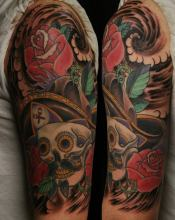 traditional skull and roses half sleeve tattoo by Kevin Riley at Studio One Tattoo Norwood PA Philadelphia